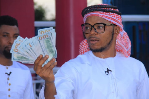 Angel Obinim's Sickness Miraculously Disappears, Seen Dancing And Flaunting $100 Notes To Celebrate His Release From Police Cells